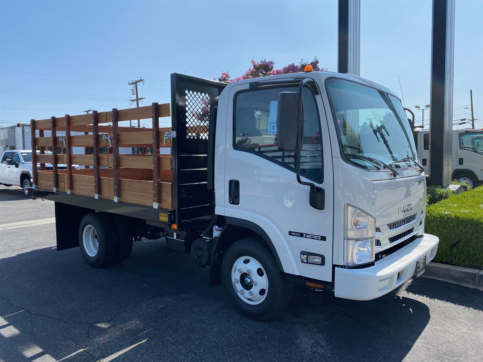 2020 Isuzu NPR Regular Cab 4x2, 12' Stake Bed #T49675 - photo 1