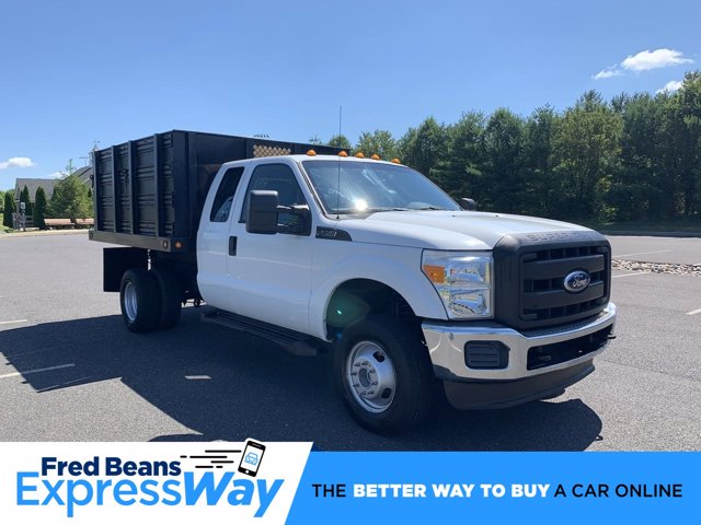 2011 Ford F-350 Super Cab DRW 4x4, Stake Bed #FU01781 - photo 1