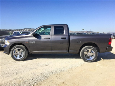 2018 Ram 1500 Quad Cab, Pickup #8R0265 - photo 8