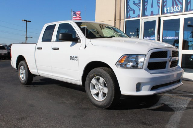 2018 Ram 1500 Quad Cab, Pickup #R181029 - photo 1