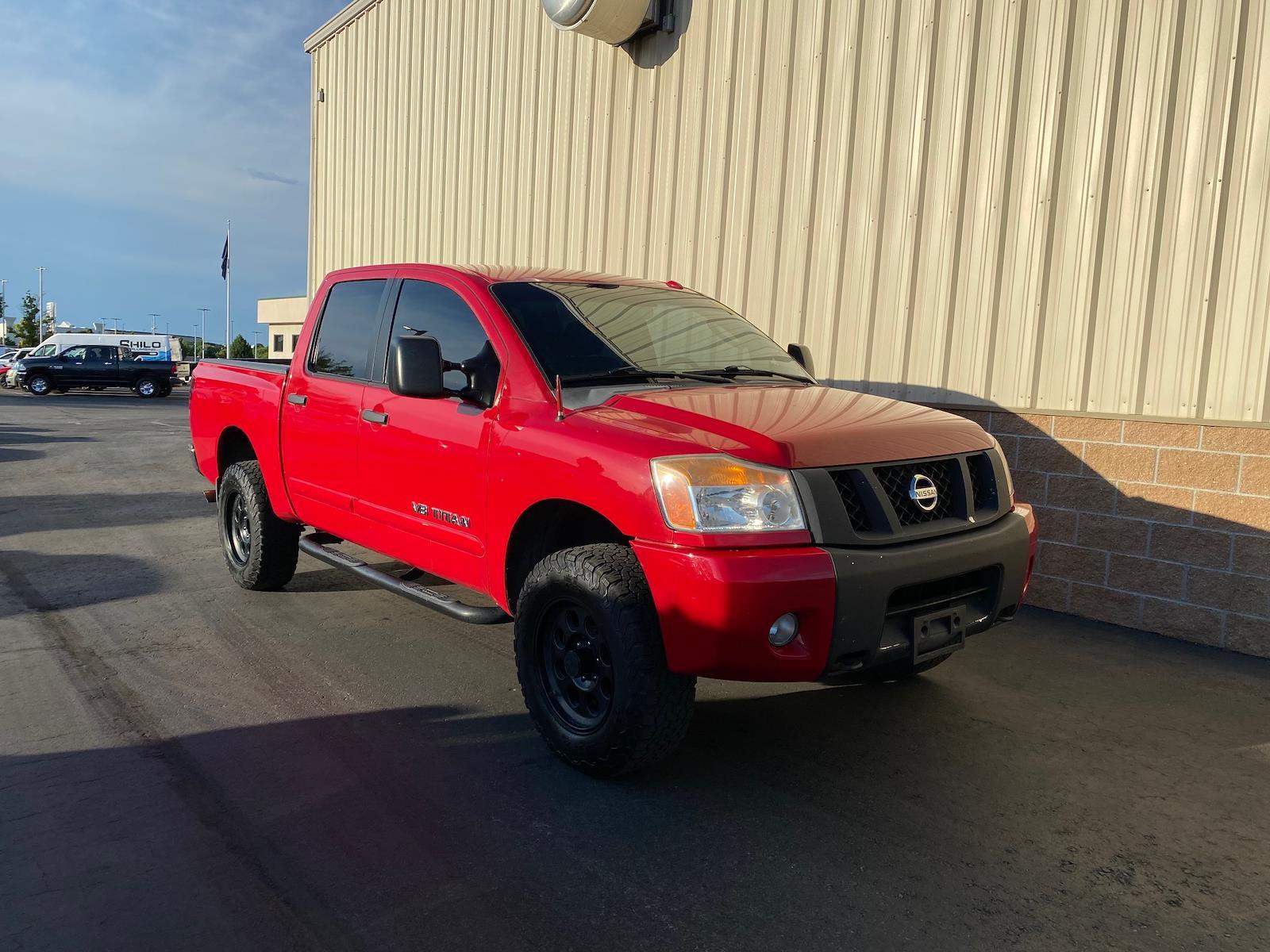 2010 Nissan Titan 4x4, Pickup #621491B - photo 1
